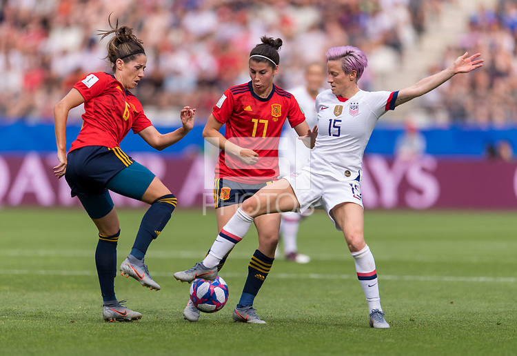 REIMS,  - JUNE 24: Vicky Losada #6 and Lucia Garcia #17 defend Megan Rapinoe #15 during a game between NT v Spain and  at Stade Auguste Delaune on June 24, 2019 in Reims, France.