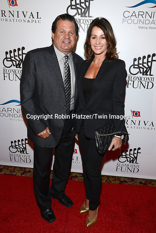 Mike Eruzione and Nadia Comaneci  attends The Buoniconti Fund to Cure Paralysis 29th Annual Gala Sport's Legends Dinner on September 29,2014 at the Waldorf Astoria Hotel  in New York City. <br /> <br /> photo by Robin Platzer/Twin Images<br />  <br /> phone number 212-935-0770