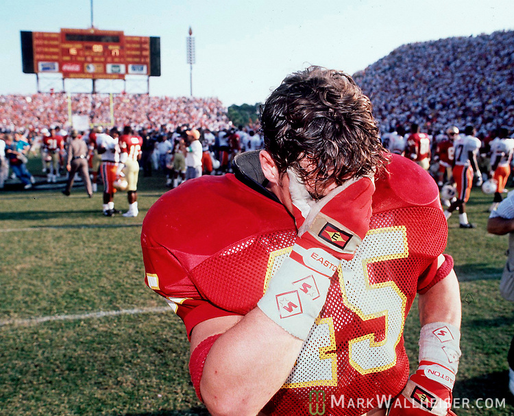 "FSU's linebacker Kirk Carruthers leaves the field after FSU's dissapointing 16-17 loss to Miami at Doak Campbell on November 16, 1991.  The Seminoles missed a last second field goal attempt in what has become known as the ""wide right"" game. (Mark Wallheiser/TallahasseeStock.com)"