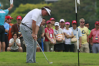 Phil Mickelson (USA) chips onto the 3rd green during Friday's resumed Round 2 of the 2011 Barclays Singapore Open, Singapore, 11th November 2011 (Photo Eoin Clarke/www.golffile.ie)