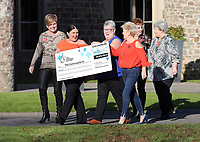 Pictured L-R: Julie Amphlett, Louise Ward, Sian Jones, Doreen Thompson, Julie Saunders and Jean Cairns with the check. Wednesday 08 November 2017<br /> Re: Presentation of hospital catering syndicate win &pound;25m in Euromillions Jackpot at Hensol Castle, south Wales, UK. Julie Saunders, 56, Doreen Thompson, 56, Louise Ward, 37, Jean Cairns, 73, SIan Jones, 54 and Julie Amphlett, 50 all work as catering staff for Neath Port Talbot Hospital in south Wales.