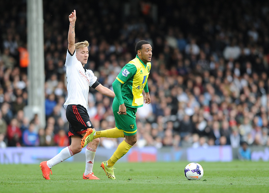 Norwich City's Nathan Redmond holds off the challenge from Fulham's Lewis Holtby<br /> <br /> Photo by Ashley Western/CameraSport<br /> <br /> Football - Barclays Premiership - Fulham v Norwich City - Saturday 12th April 2014 - Craven Cottage - London<br /> <br /> &copy; CameraSport - 43 Linden Ave. Countesthorpe. Leicester. England. LE8 5PG - Tel: +44 (0) 116 277 4147 - admin@camerasport.com - www.camerasport.com
