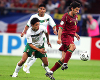 Luis Figo (7) of Portugal controls the ball in front of Gonzalo Pineda (14) of Mexico. Portugal defeated Mexico 2-1 in their FIFA World Cup Group D match at FIFA World Cup Stadium, Gelsenkirchen, Germany, June 21, 2006.