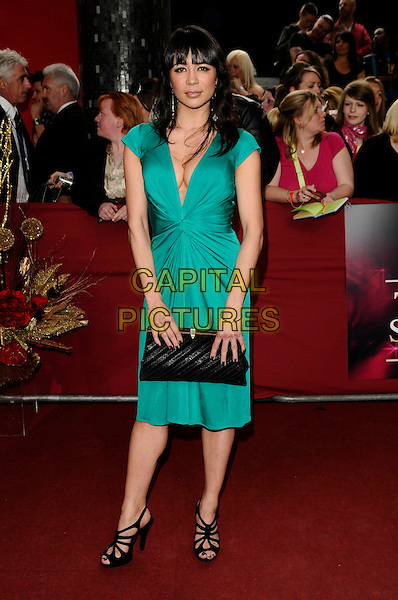 GUEST.Arrivals - the British Soap Awards 2009,.BBC Television Centre, Wood Lane, London, England, UK, May 9th 2009..soaps tv full length green dress low cut black sandals shoes clutch bag .CAP/CAN.©Can Nguyen/Capital Pictures