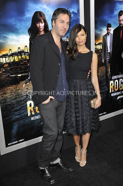 WWW.ACEPIXS.COM....March 26 2013, LA.... Ol Parker and Thandie Newton arriving at the 'Rogue' Los Angeles premiere at ArcLight Hollywood on March 26, 2013 in Hollywood, California.....By Line: Peter West/ACE Pictures......ACE Pictures, Inc...tel: 646 769 0430..Email: info@acepixs.com..www.acepixs.com