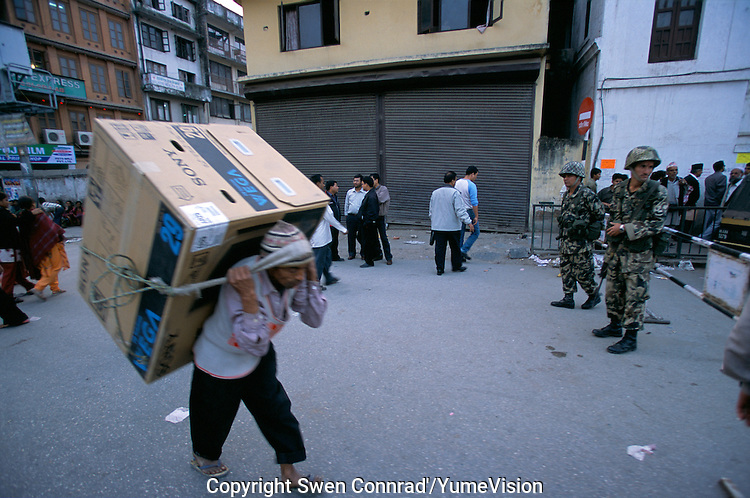 29'' Vega Sony Television carried under curfew at Durbar square in Kathmandu City, Nepal