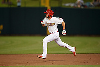 Memphis Redbirds shortstop Paul DeJong (11) runs to second base on a double during a game against the Round Rock Express on April 28, 2017 at AutoZone Park in Memphis, Tennessee.  Memphis defeated Round Rock 9-1.  (Mike Janes/Four Seam Images)