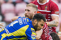 Picture by Allan McKenzie/SWpix.com - 13/07/2017 - Rugby League - Betfred Super League - Wigan Warriors v Warrington Wolves - DW Stadium, Wigan, England - Wigan's Sam Tomkins is tackled by Warrington's Ryan Atkins.