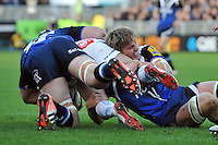 Will Skuse tackles a player to ground. Aviva Premiership match, between Bath Rugby and Exeter Chiefs on October 27, 2012 at the Recreation Ground in Bath, England. Photo by: Patrick Khachfe / Onside Images
