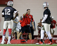 Ohio State co-offensive coordinator Tim Beck coaches quarterbacks Cardale Jones (12) and J.T. Barrett (16) during Ohio State's first practice of spring football at the Woody Hayes Athletic Center on March 10, 2015. (Adam Cairns / The Columbus Dispatch)