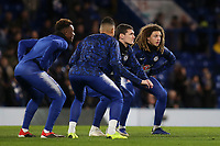 Chelsea players from left to right, Callum Hudson-Odoi, Emerson, Andreas Christensen and Ethan Ampadu embrace the stretching exercises in the pre-match warm up during Chelsea vs Newcastle United, Premier League Football at Stamford Bridge on 12th January 2019