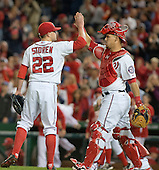 Washington Nationals closer Drew Storen (22) and catcher Wilson Ramos (40) celebrate their team's 4 - 2 victory over the New York Mets at Nationals Park in Washington, D.C. on Tuesday, September 23, 2014.  <br /> Credit: Ron Sachs / CNP<br /> (RESTRICTION: NO New York or New Jersey Newspapers or newspapers within a 75 mile radius of New York City)