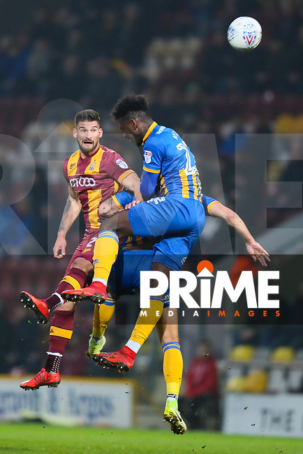 Kai Bruenker of Bradford City and Aristote Nsiasa of Shrewsbury Town during the Sky Bet League 1 match between Bradford City and Shrewsbury Town at the Northern Commercial Stadium, Bradford, England on 12 April 2018. Photo by Thomas Gadd.