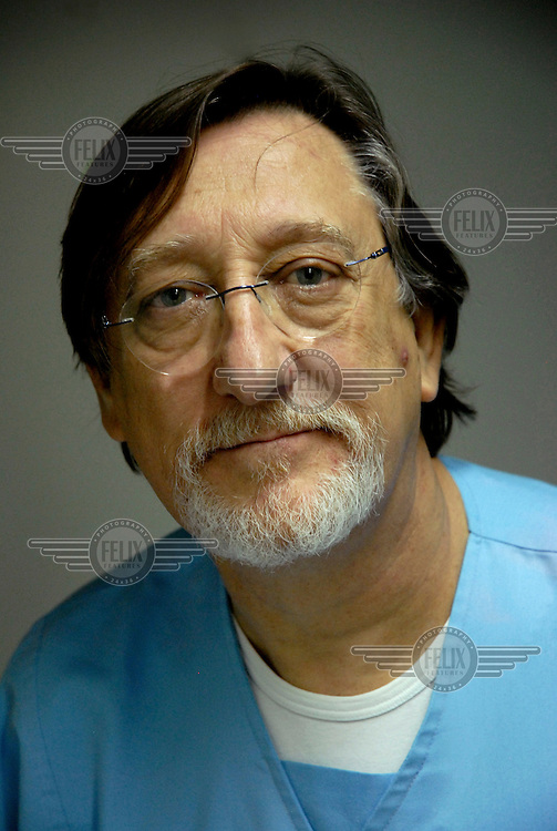 A portrait of 63 year old Dr Santiago Barambio at Tutor Medica health clinic in Barcelona.