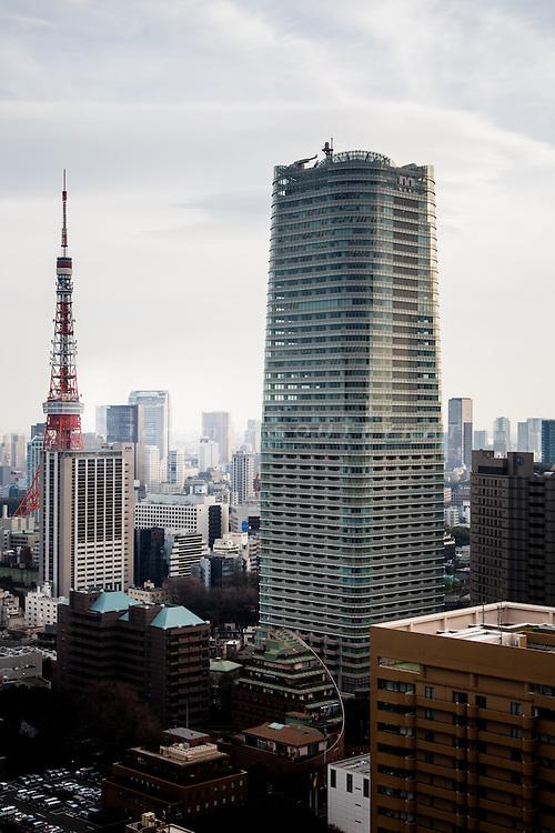 Tokyo, February 7 2012 - Ark Hills Sengokuyama Mori Tower and Tokyo Tower.
