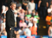 Garry Monk manager of Swansea looks on   during the Barclays Premier League match between  Chelsea and Swansea  played at Stamford Bridge, London