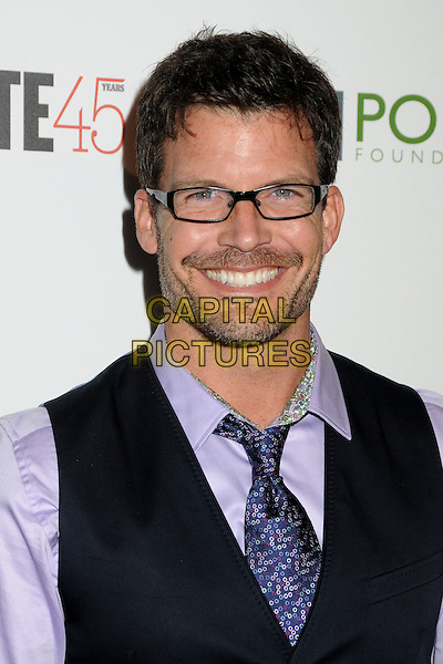Mark Deklin.The Advocate 45th Benefiting The Point Foundation held at the Beverly Hilton Hotel, Beverly Hills, California, USA..March 29th, 2012.headshot portrait stubble facial hair black waistcoat purple shirt glasses .CAP/ADM/BP.©Byron Purvis/AdMedia/Capital Pictures.