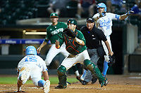 Miami Hurricanes catcher Joe Gomez (40) waits for a throw as Michael Busch (15) of the North Carolina Tar Heels slides into home plate during the second semifinal of the 2017 ACC Baseball Championship at Louisville Slugger Field on May 27, 2017 in Louisville, Kentucky. The Tar Heels defeated the Hurricanes 12-4. (Brian Westerholt/Four Seam Images)