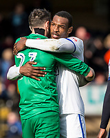 Goal scorer Captain Krystian Pearce of Mansfield Town congratulates his keeper Jake Kean at the final whistle during the Sky Bet League 2 match between Wycombe Wanderers and Mansfield Town at Adams Park, High Wycombe, England on the 14th April 2017. Photo by Liam McAvoy.