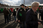 Home supporters queueing for half-time draw tickets inside The Oval, Belfast before Glentoran hosted city-rivals Cliftonville in an NIFL Premiership match. Glentoran, formed in 1892, have been based at The Oval since their formation and are historically one of Northern Ireland's 'big two' football clubs. They had an unprecendentally bad start to the 2016-17 league campaign, but came from behind to win this fixture 2-1, watched by a crowd of 1872.