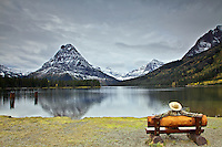 Spectator at Two Medicine Lake and the reflection of Mt. Sinopah in Glacier National Park