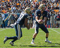 Ptt quarterback Nate Peterman (4) hands off to running back Qadree Ollison. The Pitt Panthers football team defeated the Virginia Cavaliers 26-19 on Saturday October 10, 2015 at Heinz Field, Pittsburgh, Pennsylvania.