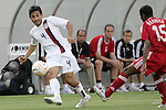 21 June 2007:  United States midfielder Pablo Mastroeni (4) passes the ball, watched by Canada's Patrice Bernier (15). The United States Men's National Team defeated the national team of Canada 2-1 in a CONCACAF Gold Cup Semifinal match at Soldier Field in Chicago, Illinois.