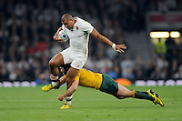 Jonathan Joseph of England is tackled by Matt Giteau of Australia during Match 26 of the Rugby World Cup 2015 between England and Australia - 03/10/2015 - Twickenham Stadium, London<br /> Mandatory Credit: Rob Munro/Stewart Communications