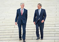 Chief Justice of the United States John G. Roberts, Jr. and Associate Justice Neil M. Gorsuch walk down the front steps of the US Supreme Court Building as they pose for photos after the investiture ceremony for Justice Gorsuch in Washington, DC on Thursday, June 15, 2017. <br /> Credit: Ron Sachs / CNP /MediaPunch