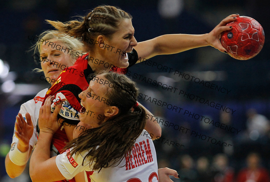 BELGRADE, SERBIA - DECEMBER 16: Katarina Bulatovic of Montenegro (C) is challenged by Camilla Herrem (R) of Norway during the Women's European Handball Championship 2012 gold medal match between Norway and Montenegro at Arena Hall on December 16, 2012 in Belgrade, Serbia. (Photo by Srdjan Stevanovic/Getty Images)