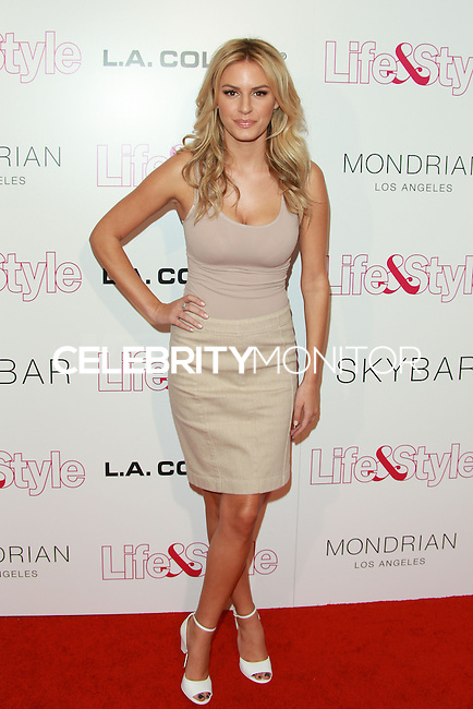 WEST HOLLYWOOD, CA, USA - OCTOBER 23: Morgan Stewart arrives at the Life & Style Weekly 10 Year Anniversary Party held at SkyBar at the Mondrian Los Angeles on October 23, 2014 in West Hollywood, California, United States. (Photo by David Acosta/Celebrity Monitor)