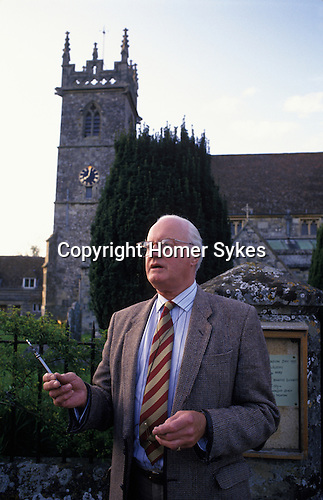 Key Auction  Great Wishford, Wishford Magna, Wiltshire England 1985 the churchwarden  auctioning the grazing rights for the following year at dusk on Rogation Monday. Usually April. 1980s