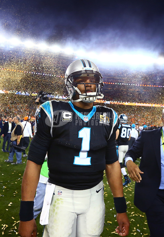 Feb 7, 2016; Santa Clara, CA, USA; Confetti falls as Carolina Panthers quarterback Cam Newton (1) walks off the field after Super Bowl 50 against the Denver Broncos at Levi's Stadium. Mandatory Credit: Mark J. Rebilas-USA TODAY Sports