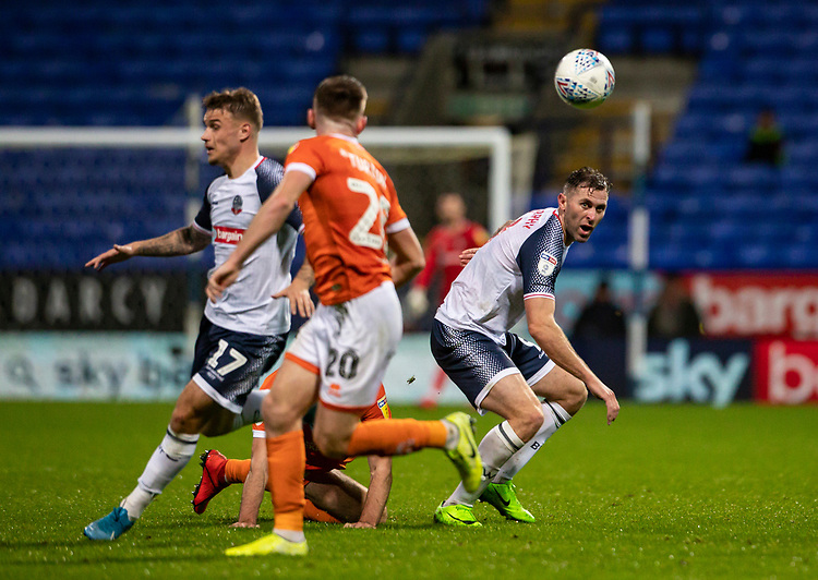Bolton Wanderers' Daryl Murphy (right) plays a through ball<br /> <br /> Photographer Andrew Kearns/CameraSport<br /> <br /> The EFL Sky Bet League One - Bolton Wanderers v Blackpool - Monday 7th October 2019 - University of Bolton Stadium - Bolton<br /> <br /> World Copyright © 2019 CameraSport. All rights reserved. 43 Linden Ave. Countesthorpe. Leicester. England. LE8 5PG - Tel: +44 (0) 116 277 4147 - admin@camerasport.com - www.camerasport.com