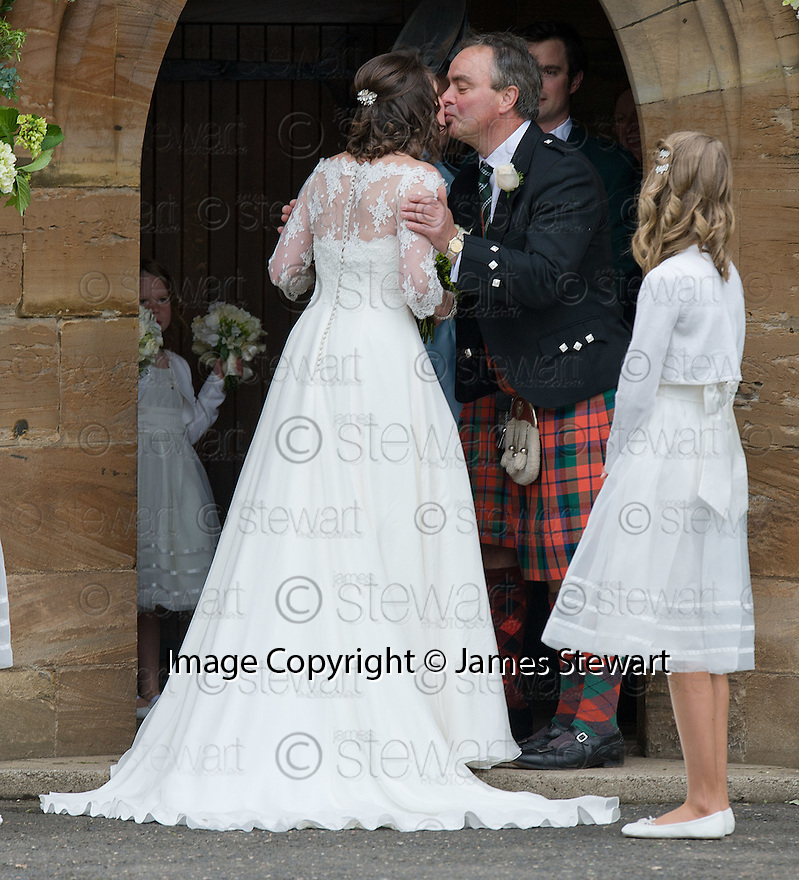 Bride, Camilla Hook, gets from her Father (?) as she makes her way into Aberlady Church to marry Sam Holland, grandson of Lord Attenborough  .......