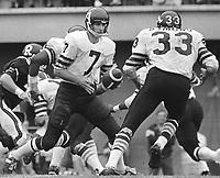 Joe Theismann Toronto Argonauts Quarterback hands the ball off to Bill Symons fullback 1971. Copyright photograph Scott Grant/
