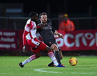 Lincoln City's Neal Eardley clears under pressure from Stevenage's Emmanuel Sonupe<br /> <br /> Photographer Andrew Vaughan/CameraSport<br /> <br /> The EFL Sky Bet League Two - Stevenage v Lincoln City - Saturday 8th December 2018 - The Lamex Stadium - Stevenage<br /> <br /> World Copyright © 2018 CameraSport. All rights reserved. 43 Linden Ave. Countesthorpe. Leicester. England. LE8 5PG - Tel: +44 (0) 116 277 4147 - admin@camerasport.com - www.camerasport.com