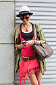 June 11, 2012, Tokyo, Japan - Emi Schemmer, 22, Creative Director and Designer. Hat - SAWA Vaughters, Sunglassers - Morgan, Shoes - Michael Kors, Necklace and bracelet - custom made by a artisan in Tokyo, Black shirt - UNIQLO, Red Shirt - ZARA, Belt - handmade by a artisan in Tokyo, Handbag - Louis Vuitton. Today's fashion point is summer style. (Photo by Christopher Jue/Nippon News)