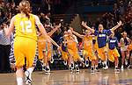 SIOUX FALLS, SD - MARCH 12:  The South Dakota State University Women's team storm the court following the Jackrabbits 56-53 win over the University of South Dakota at the 2013 Women's Summit League Championship Game on Tuesday afternoon at the Sioux Falls Arena. (Photo by Dave Eggen/Inertia)
