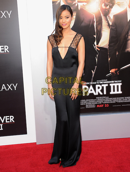"""Jamie Chung.""""The Hangover Part III"""" Los Angeles Premiere held at the Westwood Village Theater, Los Angeles, California, USA..May 20th, 2013.full length black lace dress plunging neckline cleavage .CAP/DVS.©DVS/Capital Pictures"""