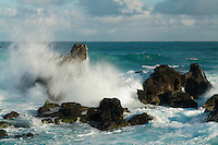 Breaking waves on the rocks at Hookipa on Maui in Hawaii