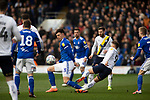 The home side's Josh Earl tackles Matty Taylor during the first-half as Ipswich Town (in blue) play Oxford United in a SkyBet League One fixture at Portman Road. Both teams were in contention for promotion as the season entered its final months. The visitors won the match 1-0 through a 44th-minute Matty Taylor goal, watched by a crowd of 19,363.