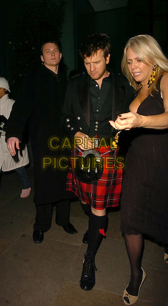 EWAN McGREGOR.Burns' Night - VIP fundraising party at Asia de Cuba, WC@, London, UK..January 25th, 2006.Ref: CAN.full length kilt red black jacket bag.www.capitalpictures.com.sales@capitalpictures.com.©Capital Pictures