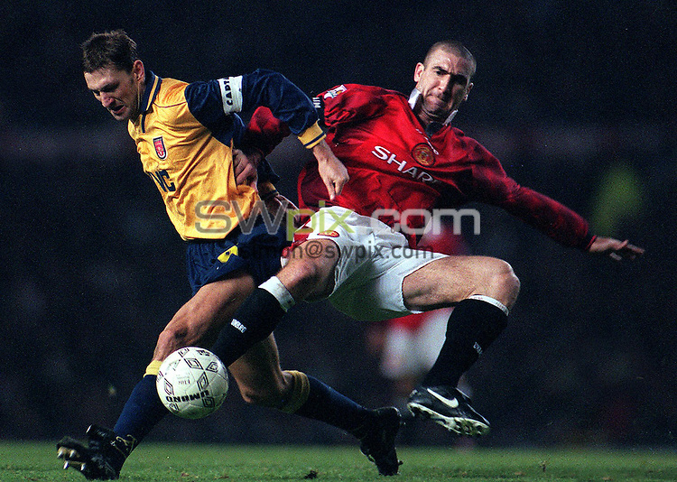 Pix: Michael Steele/SWPIX. Manchester United v Arsenal...COPYWRIGHT PICTURE>>SIMON WILKINSON>>01943 436649>>..Manchester United's captain Eric Cantona lunges into a tackle with Arsenals captain Tony Adams