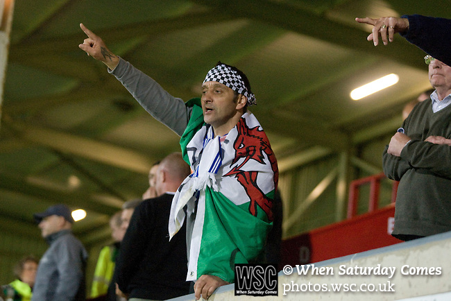 Bangor City 0 FC Honka 1, 23/07/2009. Racecourse Ground, Europa League. A Bangor City supporter in the main stand at Wrexham's Racecourse Ground, the venue for their sides Europa League second round second leg tie against FC Honka from Finland, acknowledges his teams efforts at the end of the match. The match had to be staged away from City's Farrar Road ground as it did not meet UEFA's stadium standards. The Finns won 1-0 in Wales to go through 3-0 on aggregate in front of 602 spectators in the first season of the newly-introduced competition which replaced the UEFA Cup. Photo by Colin McPherson.