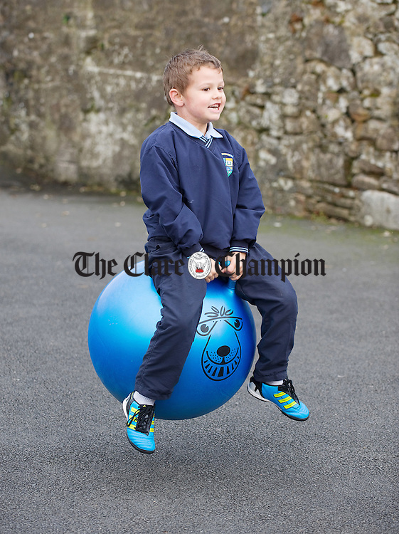 Rhys Nolan on a space hopper  at Bodyke national school. Photograph by John Kelly.