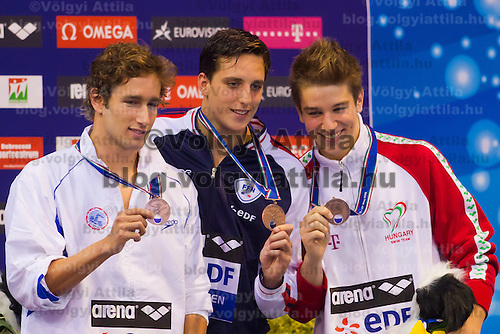 Three bronze medalists finishing with 25.14 seconds Guy Barnea (L) of Israel, Dorian Gandin (C) of France and Richard Bohus (R) of Hungary celebrate their victory in the Men's 50m Backstroke final of the 31th European Swimming Championships in Debrecen, Hungary on May 24, 2012. ATTILA VOLGYI