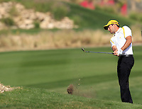 Gareth Maybin (NIR) chips onto the 16th green during Friday's Round 3 of the Commercial Bank Qatar Masters 2013 at Doha Golf Club, Doha, Qatar 25th January 2013 .Photo Eoin Clarke/www.golffile.ie