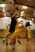 Junior Tall Blacks forward Jordan Ngatai knocks down Anthony Drmic. 2010 FIBA Oceania U18 Championship - NZ Junior Tall Blacks v Australian Emus at Arena Manawatu, Palmerston North on Friday, 17 September 2010. Photo: Dave Lintott/lintottphoto.co.nz