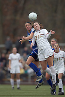 Hofstra University midfielder Courtney Breen (21) and Boston College midfielder Zoe Lombard (20) battle for head ball. Boston College defeated Hofstra University, 3-1, in second round NCAA tournament match at Newton Soccer Field, Newton, MA.